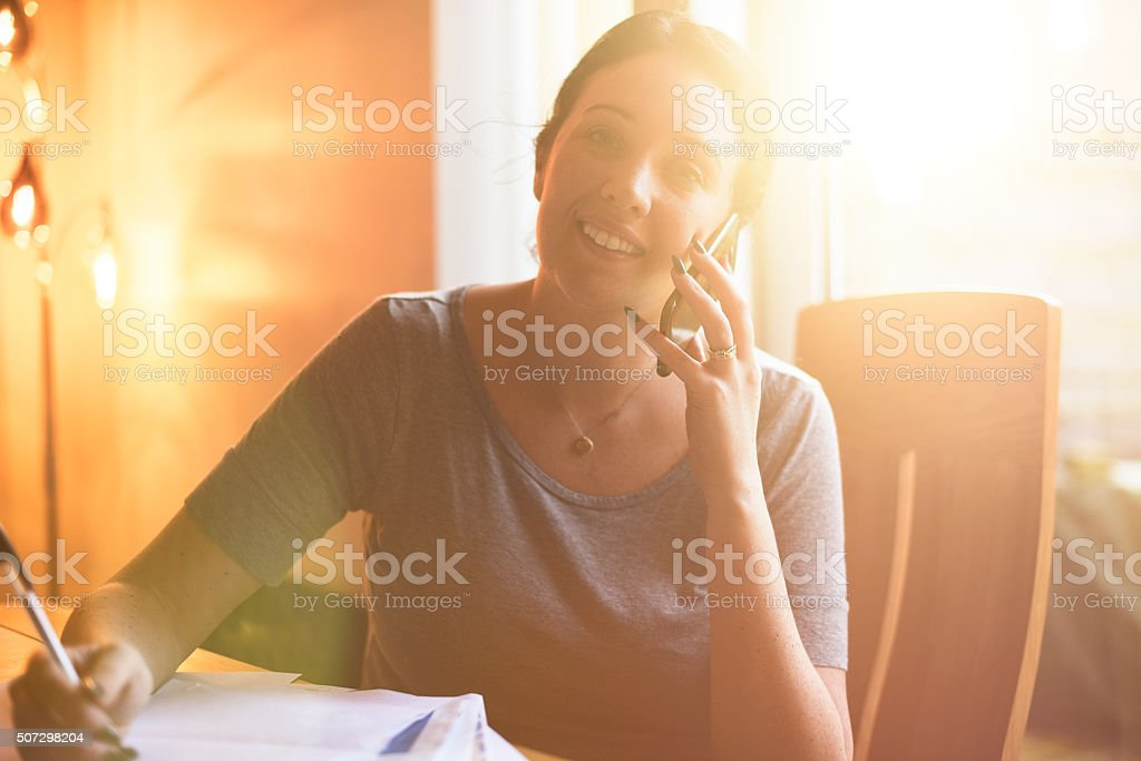 Young woman has some good news on the phone. stock photo