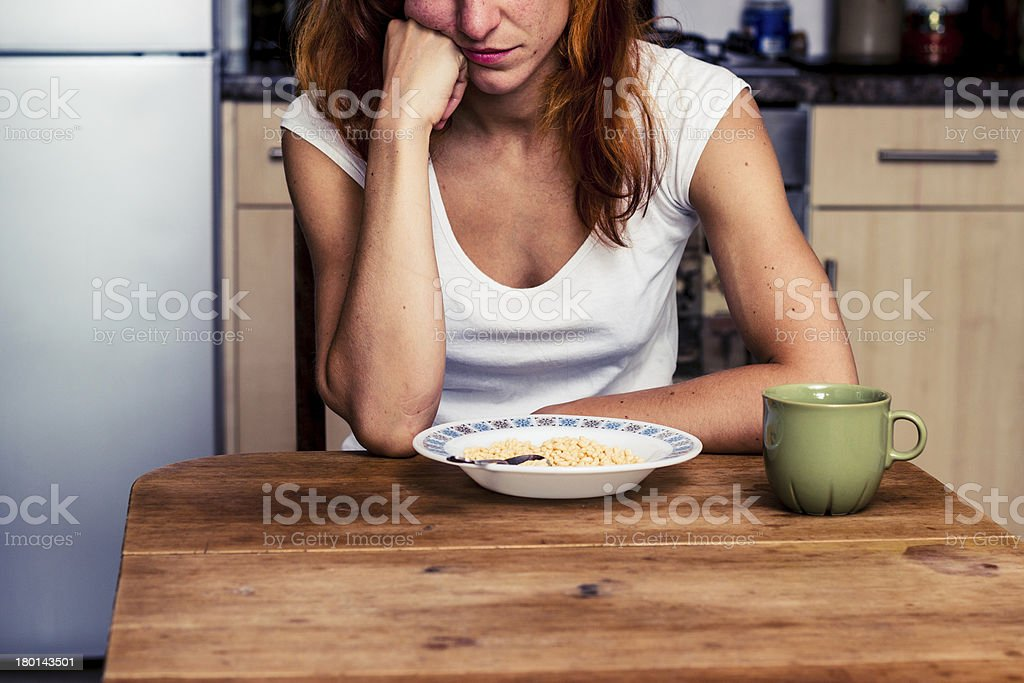 Young woman hates cereal stock photo