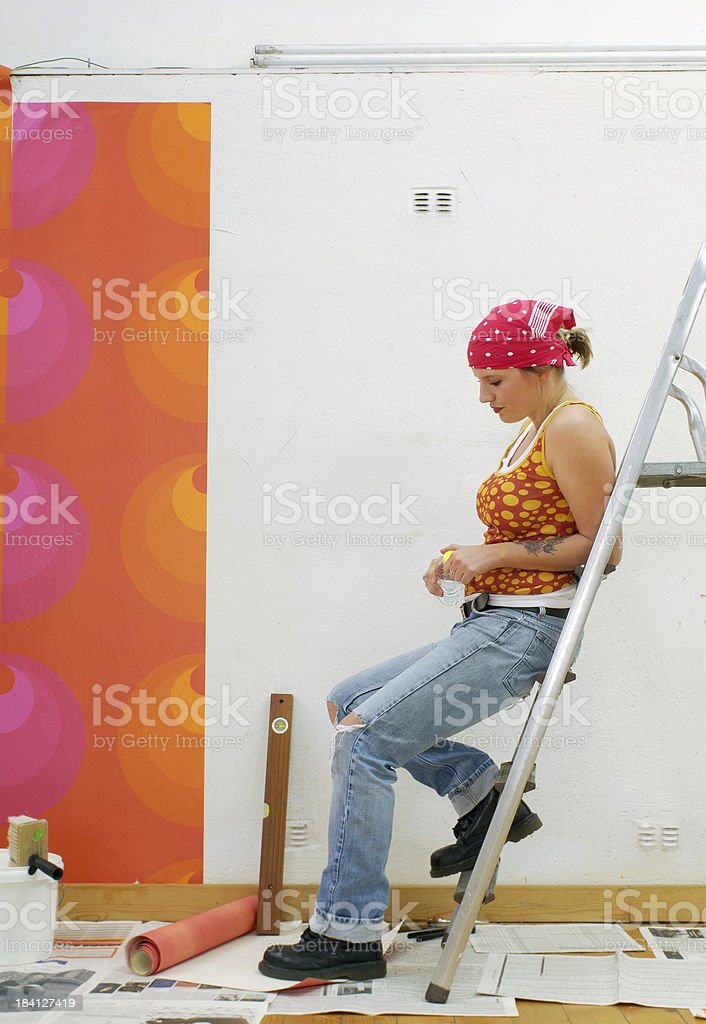 Young woman having a break after home improvement royalty-free stock photo