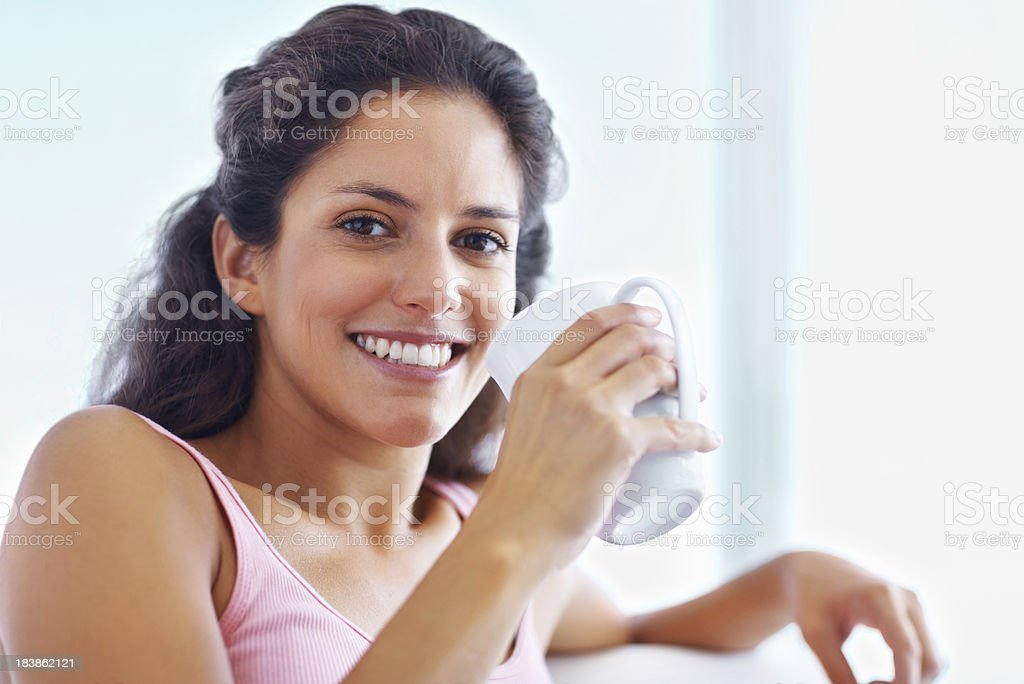 Young woman having a cup of coffee royalty-free stock photo