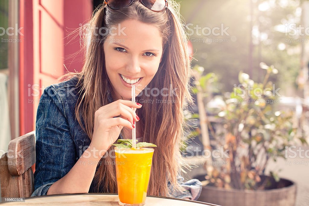 Young woman having a fresh drink stock photo