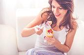 Young woman having a fruit salad