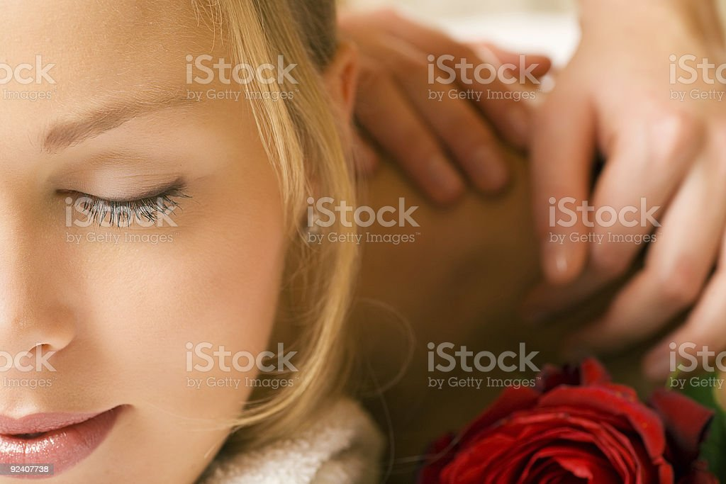 A young woman having a massage royalty-free stock photo