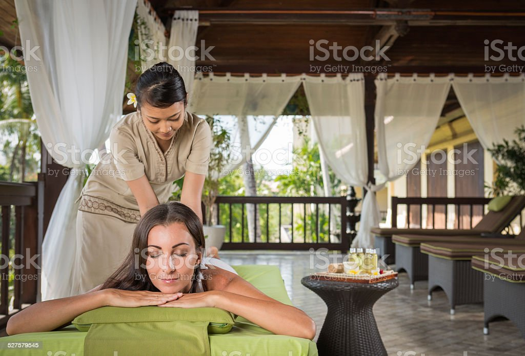 Young woman having a massage treatment stock photo