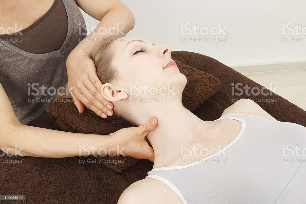 Young woman having a neck massage stock photo