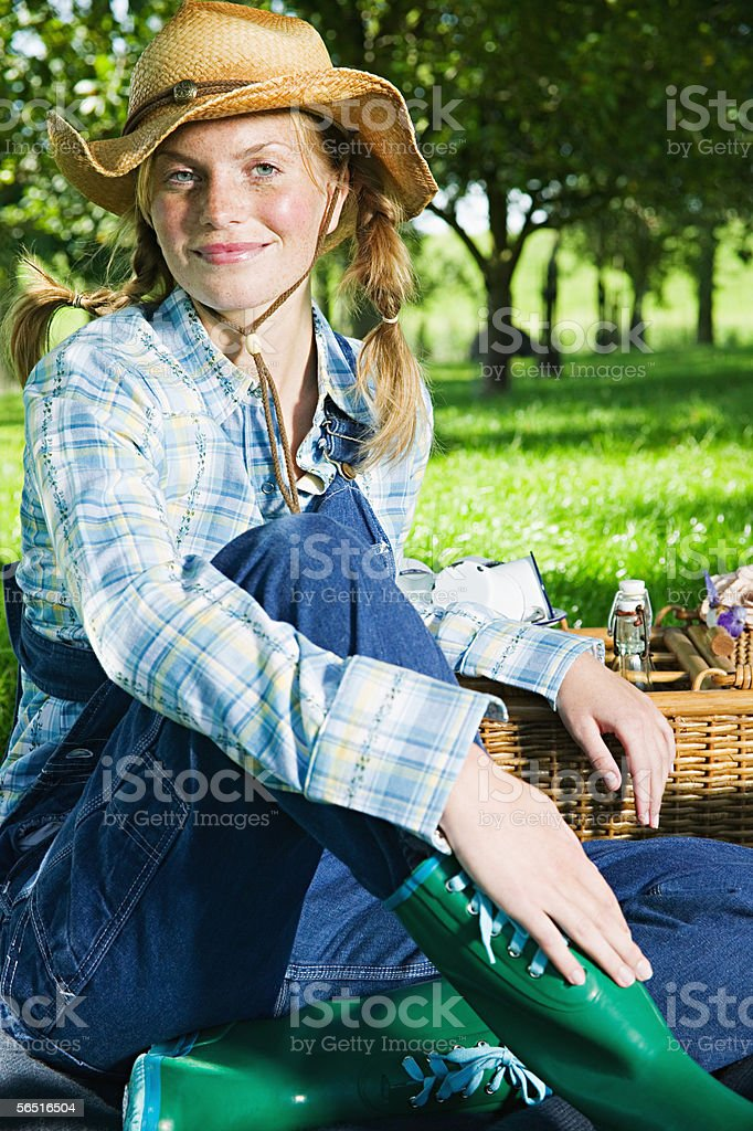 Young woman having a picnic stock photo