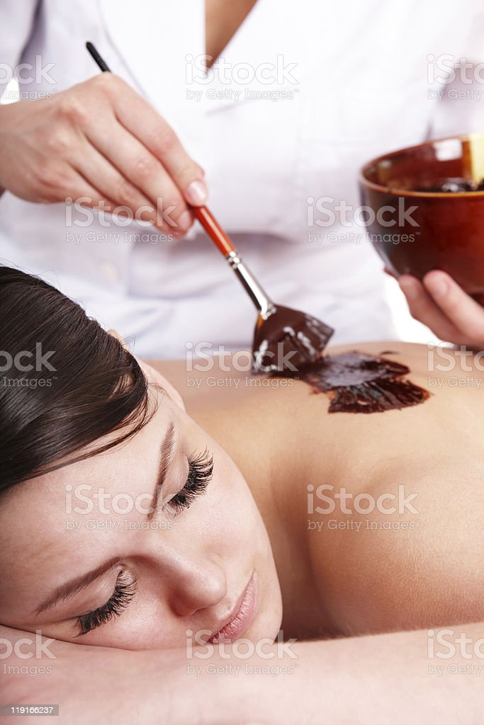 Young woman having a relaxing chocolate body mask stock photo