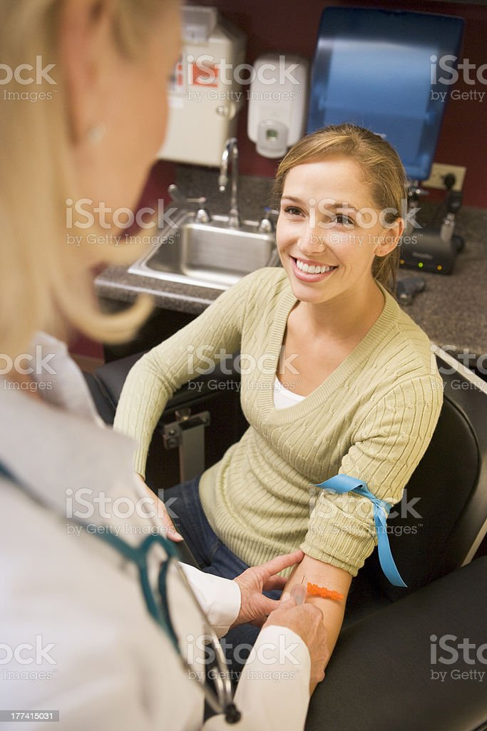 Young Woman Having Blood Test Done stock photo