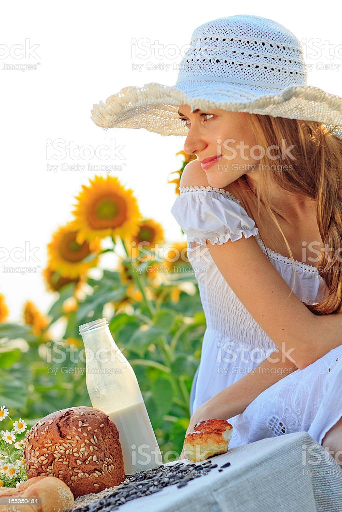 Young woman having breakfast on nature royalty-free stock photo