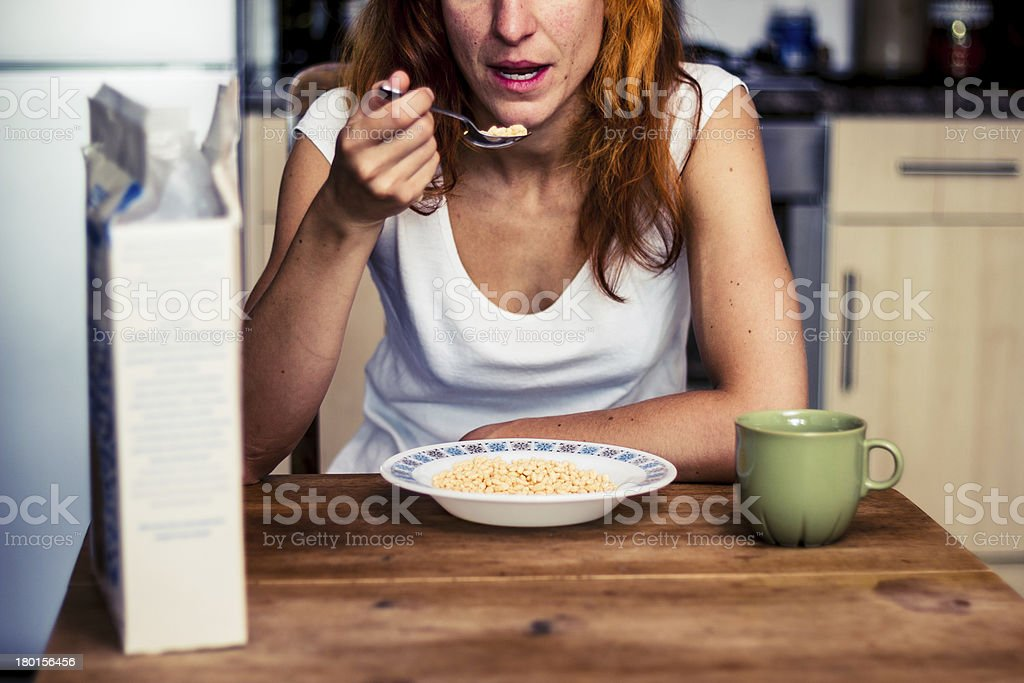 Young woman having cereal for breakfast royalty-free stock photo