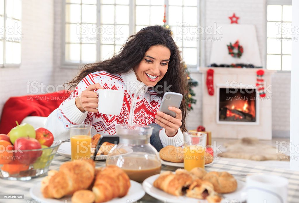 Young woman having christmas breakfast at home stock photo