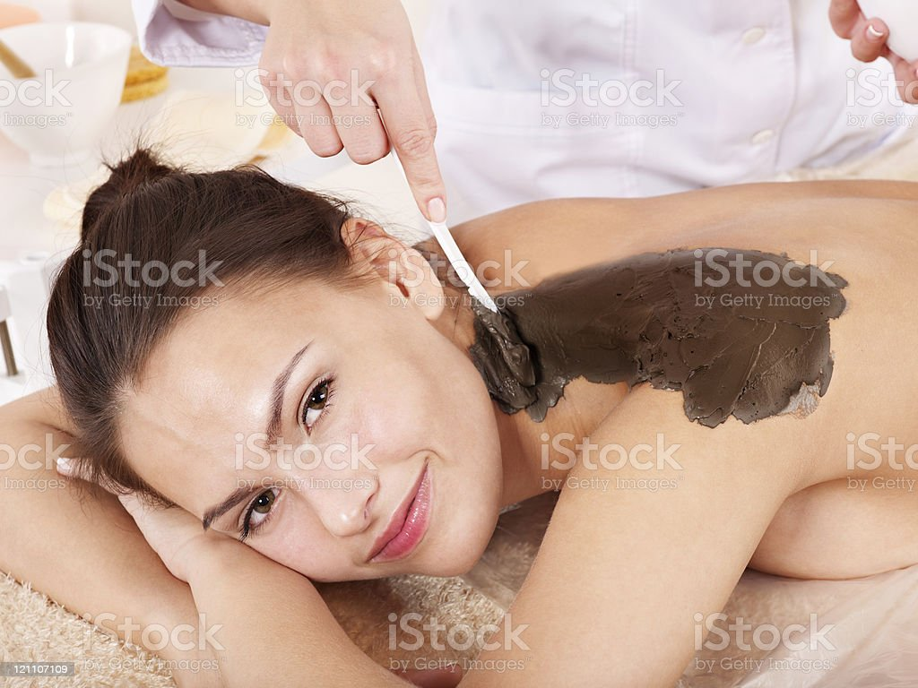 Young woman  having clay body mask. royalty-free stock photo