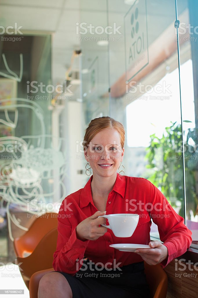 Young woman having coffee in cafe royalty-free stock photo