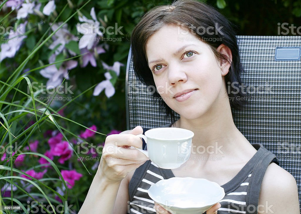 Young woman having coffee royalty-free stock photo