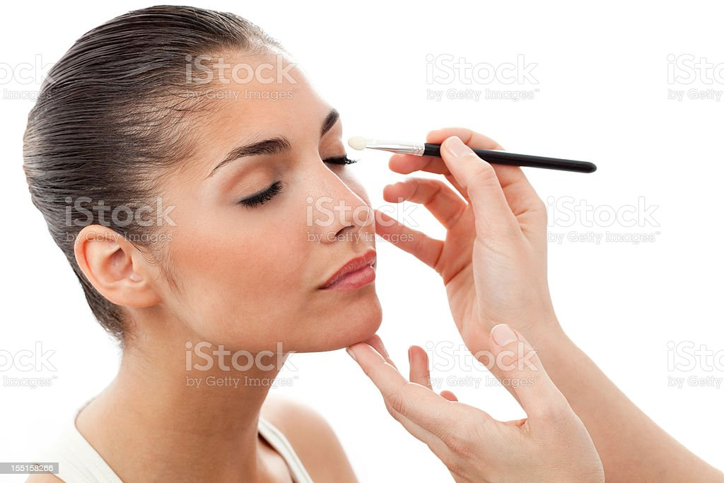 Young Woman Having Eye Makeup Applied - Isolated royalty-free stock photo