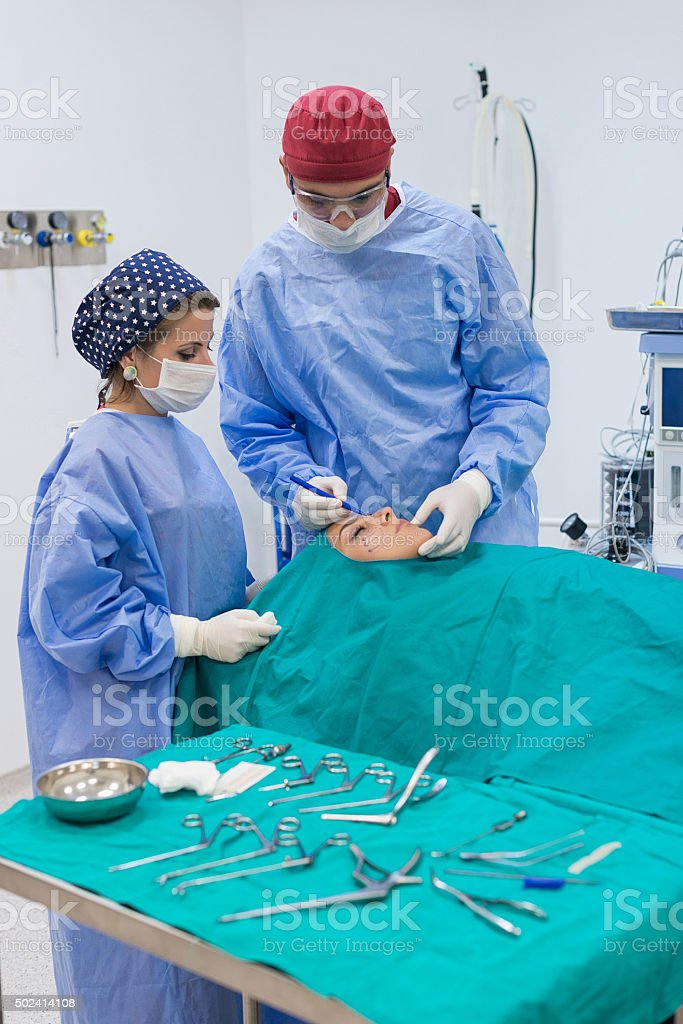 Young woman having facial plastic surgery stock photo