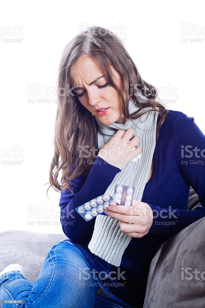 Young woman having flu at home stock photo