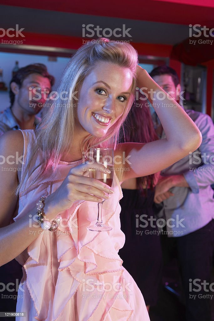 Young Woman Having Fun In Busy Bar royalty-free stock photo