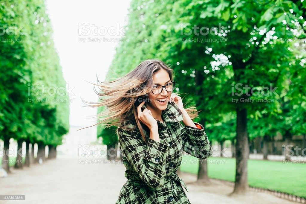 Young woman having fun in the park stock photo