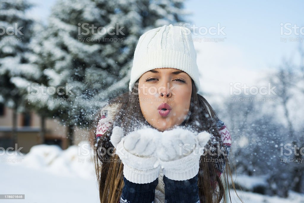 A young woman having fun in the winter snow royalty-free stock photo