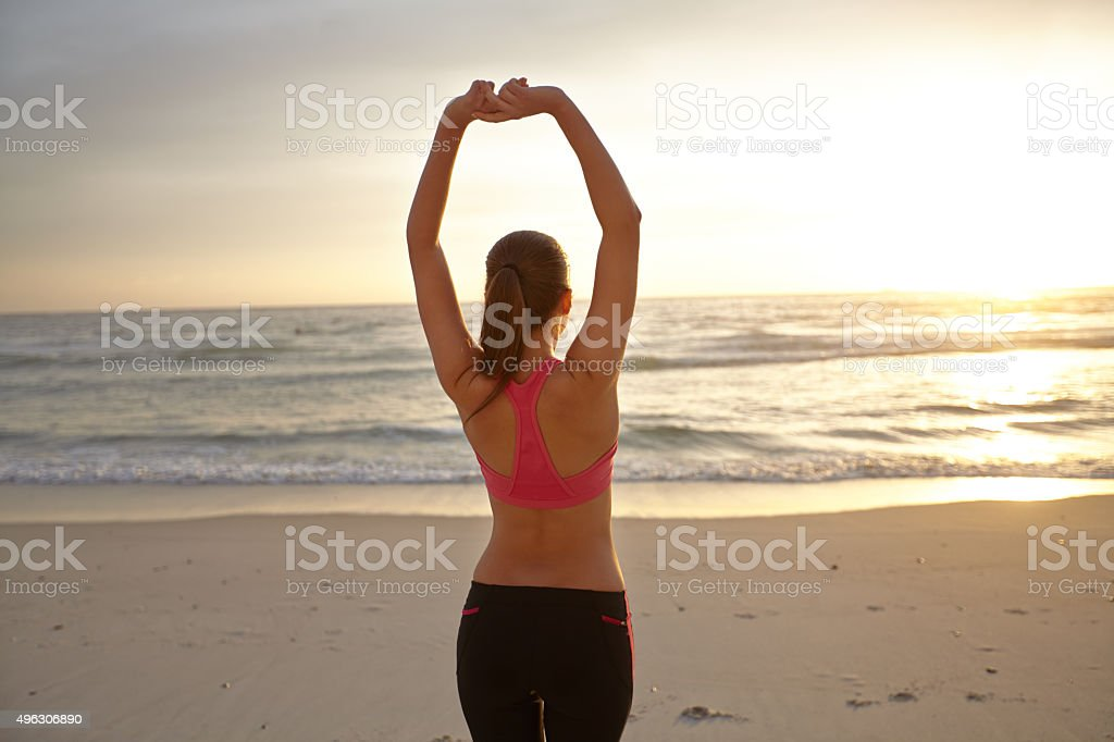 Young woman having fun on a beach stock photo