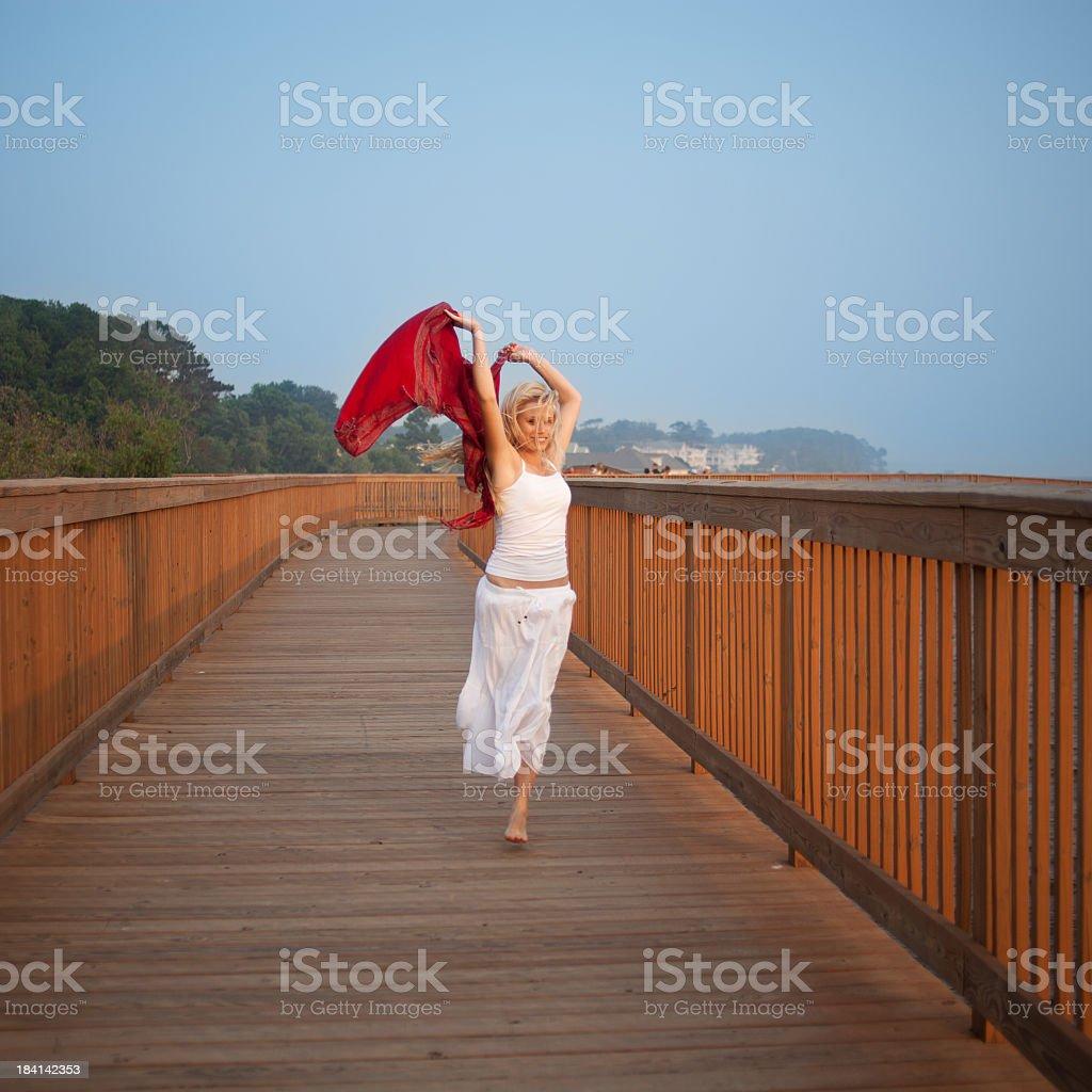 Young woman having fun on the beach stock photo