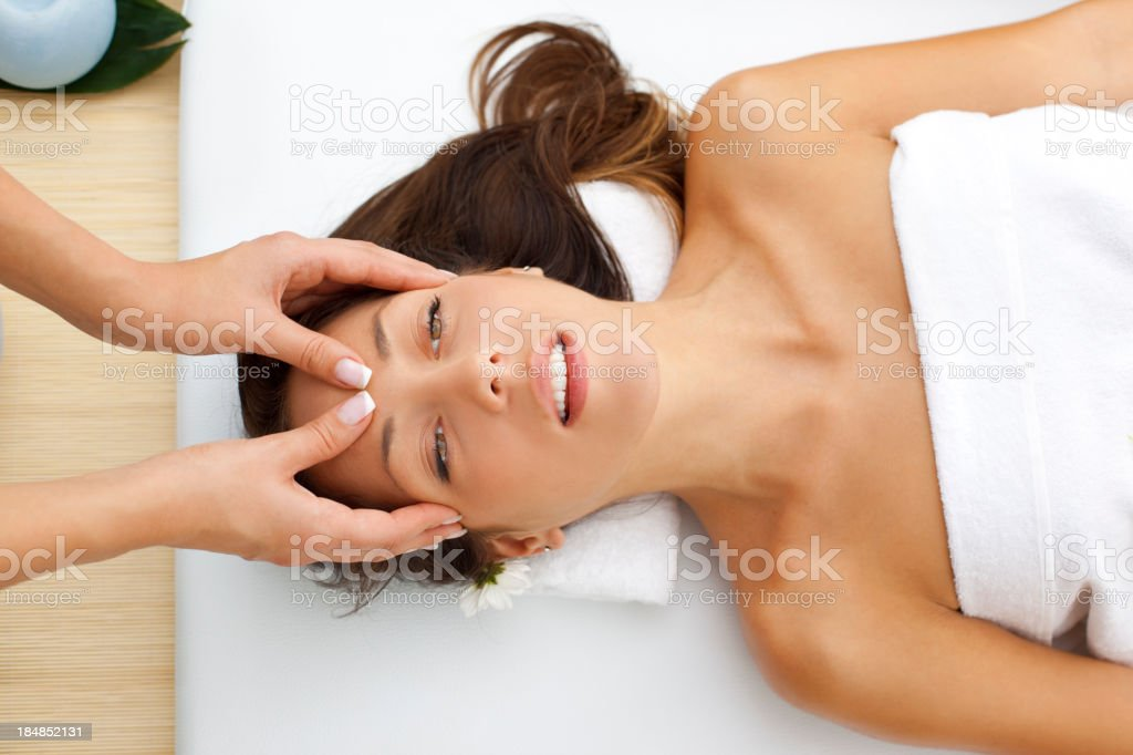 Young Woman Having Head Massage At Spa Center royalty-free stock photo