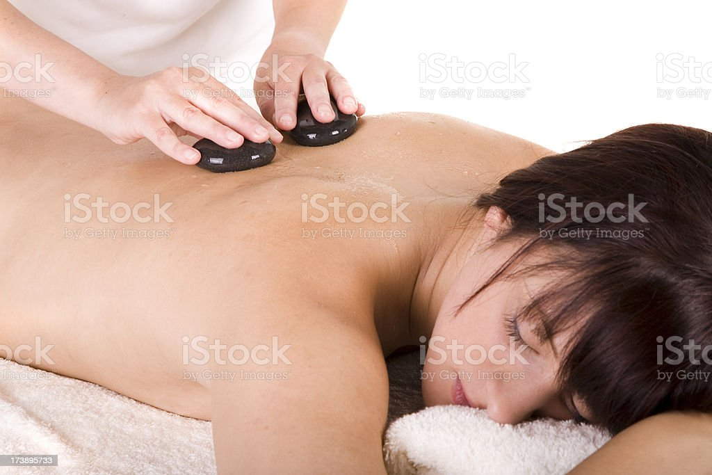 Young woman having hot stone massage royalty-free stock photo