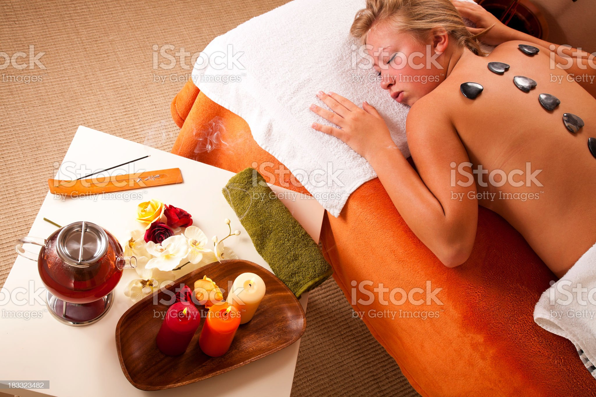 Young woman having hot stone therapy royalty-free stock photo