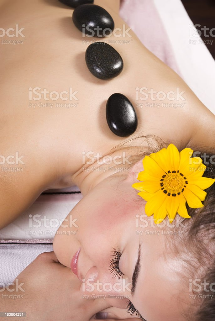 Young woman having lastone therapy in spa royalty-free stock photo