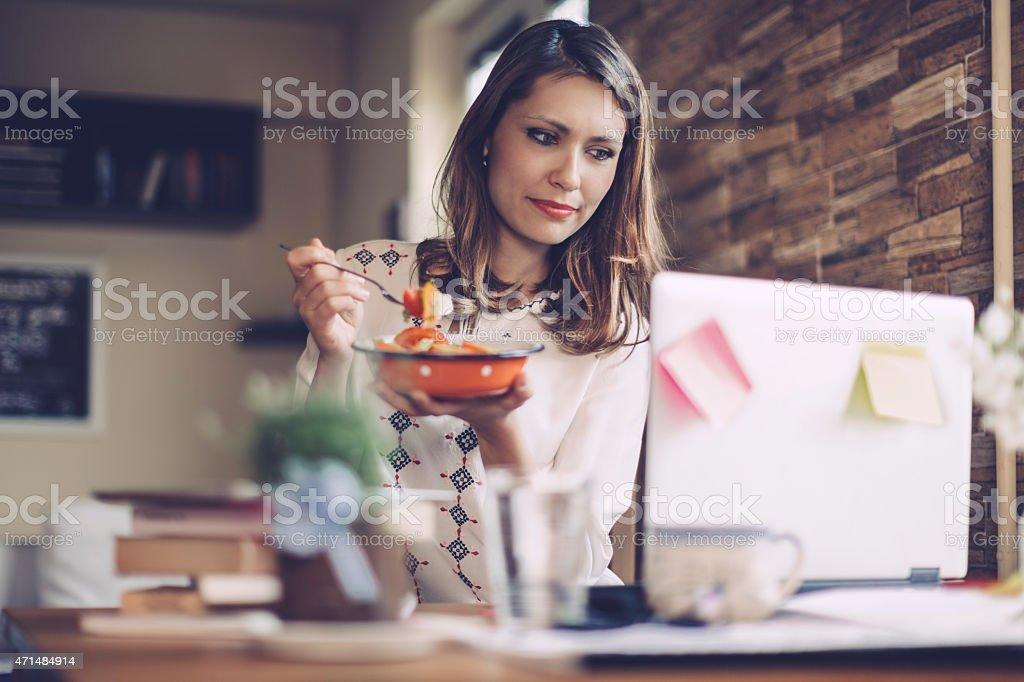 Young woman having lunch break stock photo