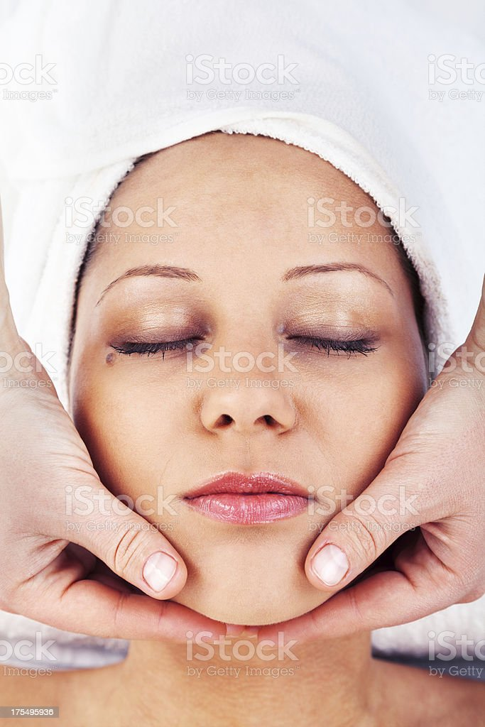 Young woman having massage royalty-free stock photo