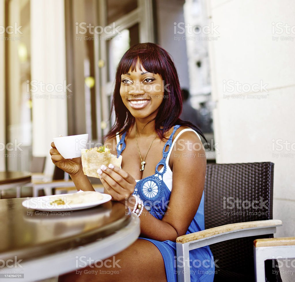 Young Woman having snack in outdoors cafe royalty-free stock photo