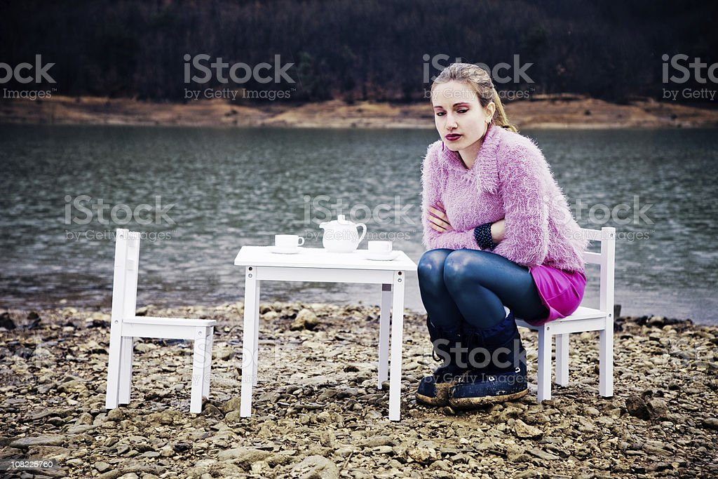 Young Woman Having Tea Party on Riverbank royalty-free stock photo