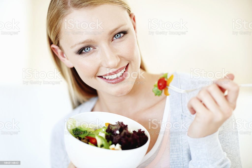 Young woman having vegetable salad royalty-free stock photo