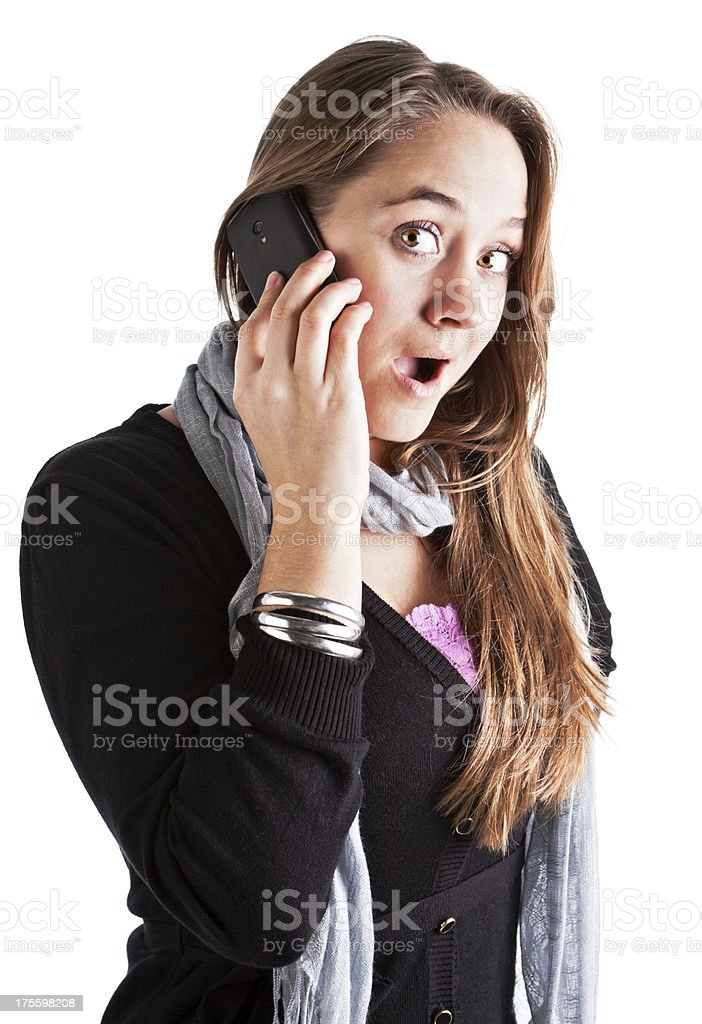Young woman hears surprising or shocking news on mobile phone stock photo