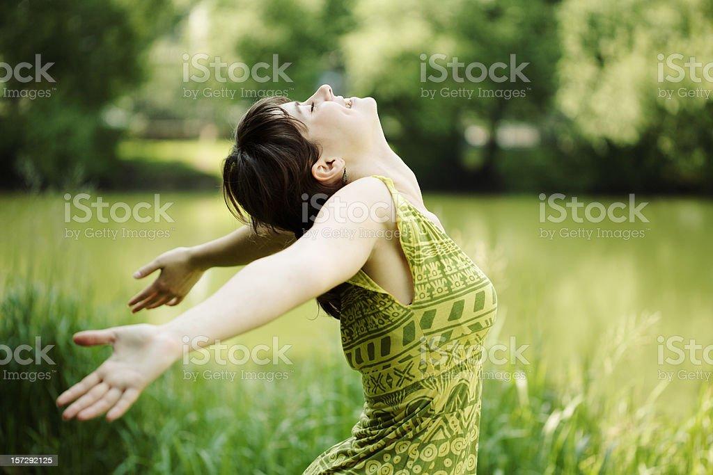 Young woman, her face upward, enjoying the sun stock photo
