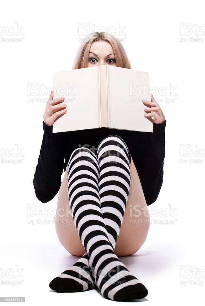 young woman hide about book stock photo