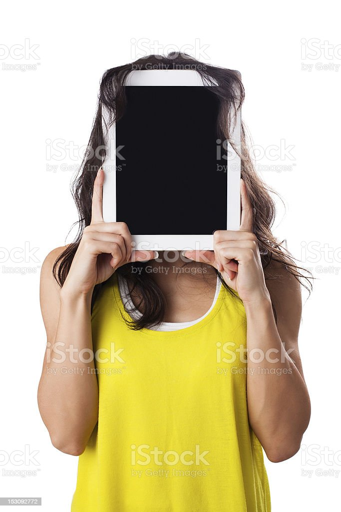 Young woman hiding behind Digital Tablet, isolated on white royalty-free stock photo