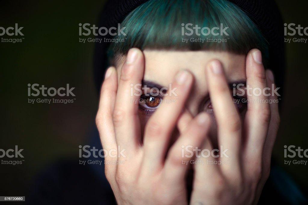 Young Woman hiding face stock photo