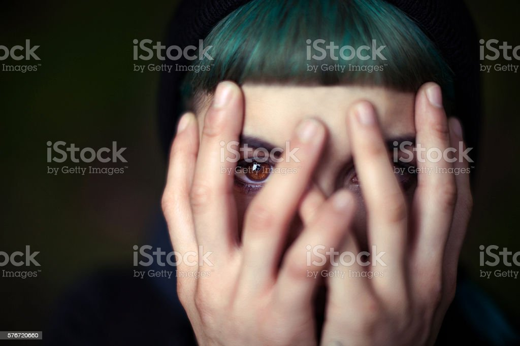Young Woman hiding face stock photo