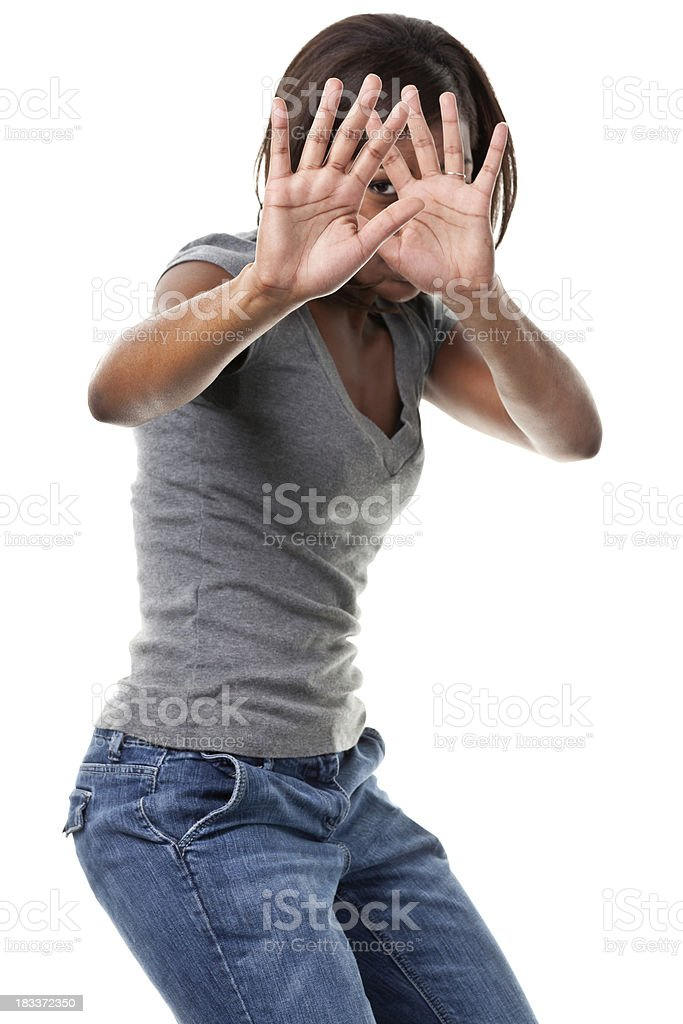 Young Woman Hiding Face With Hands stock photo