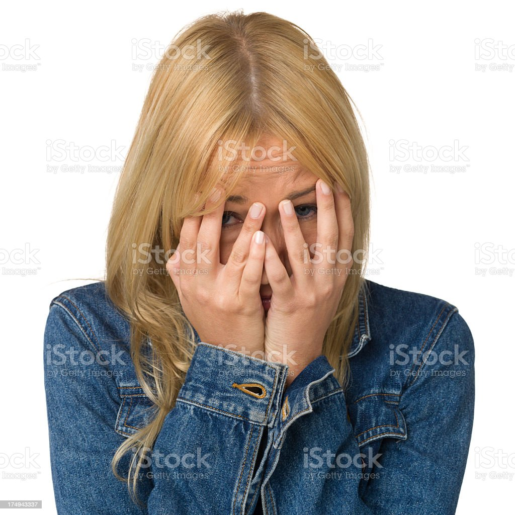 Young Woman Hiding Head In Hands royalty-free stock photo