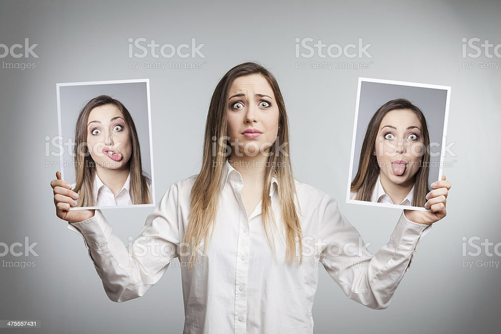 Young woman hiding her emotions stock photo