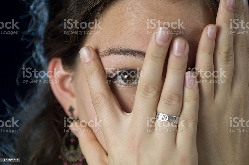 Young woman hiding royalty-free stock photo