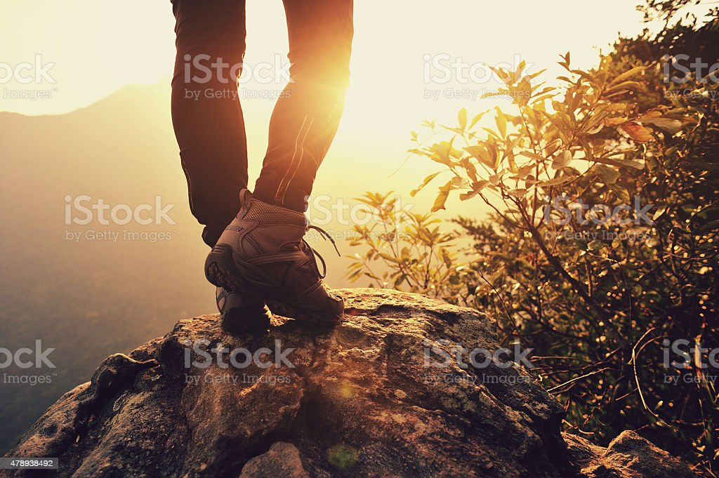 young woman hiker stand on  sunrise mountain peak stock photo