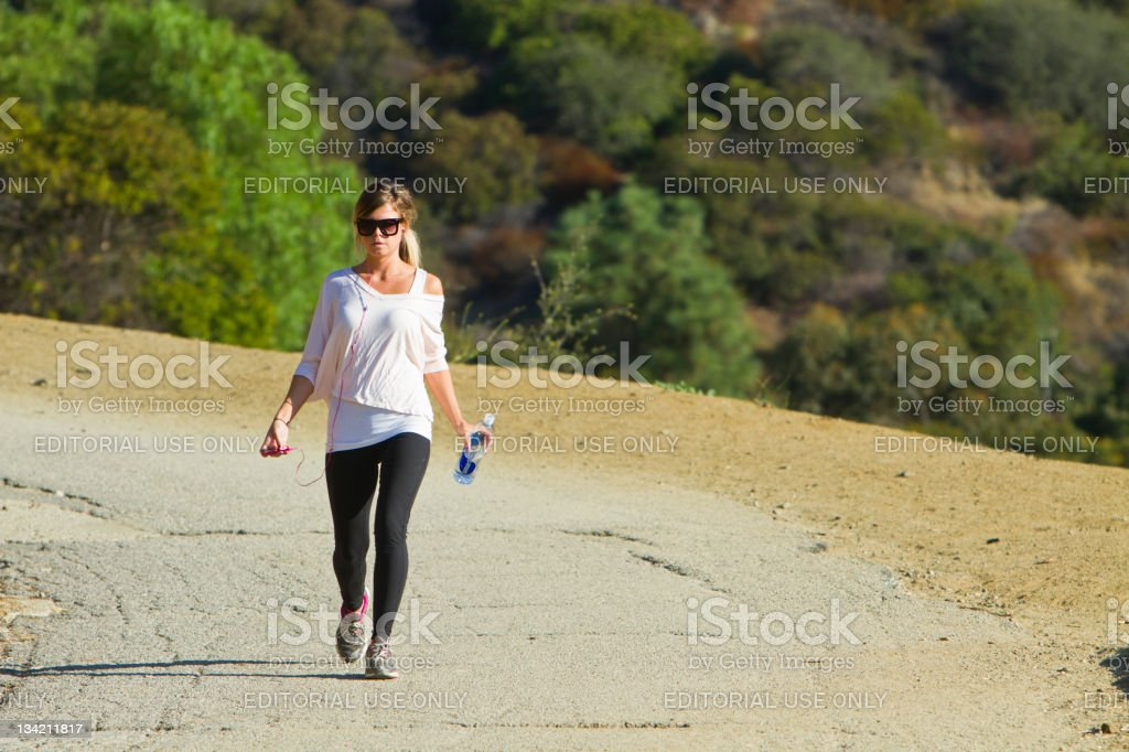 Young Woman Hikes In The Early Morning stock photo
