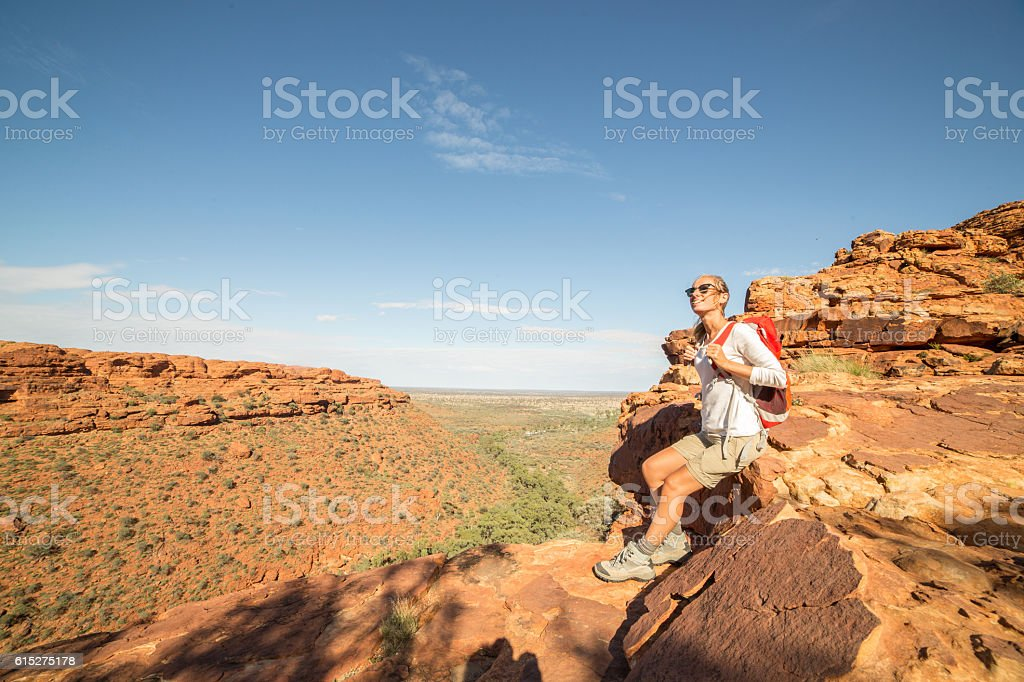 Young woman hiking at the Kings Canyon, Australia stock photo