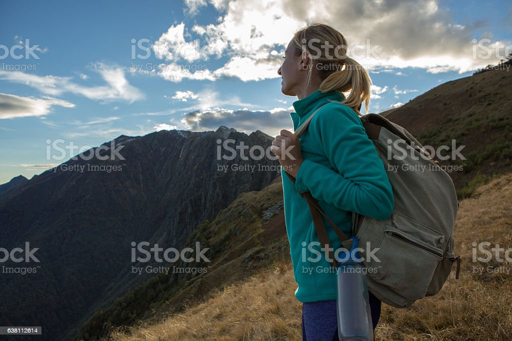 Young woman hiking in Autumn, Switzerland stock photo