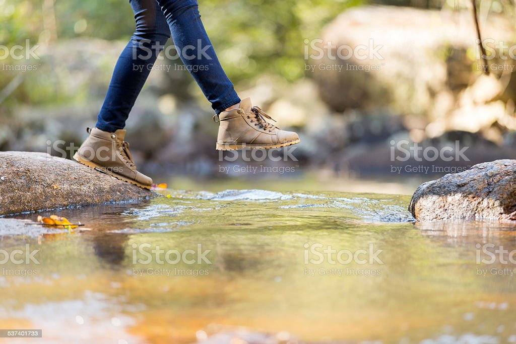 young woman hiking in mountain stock photo